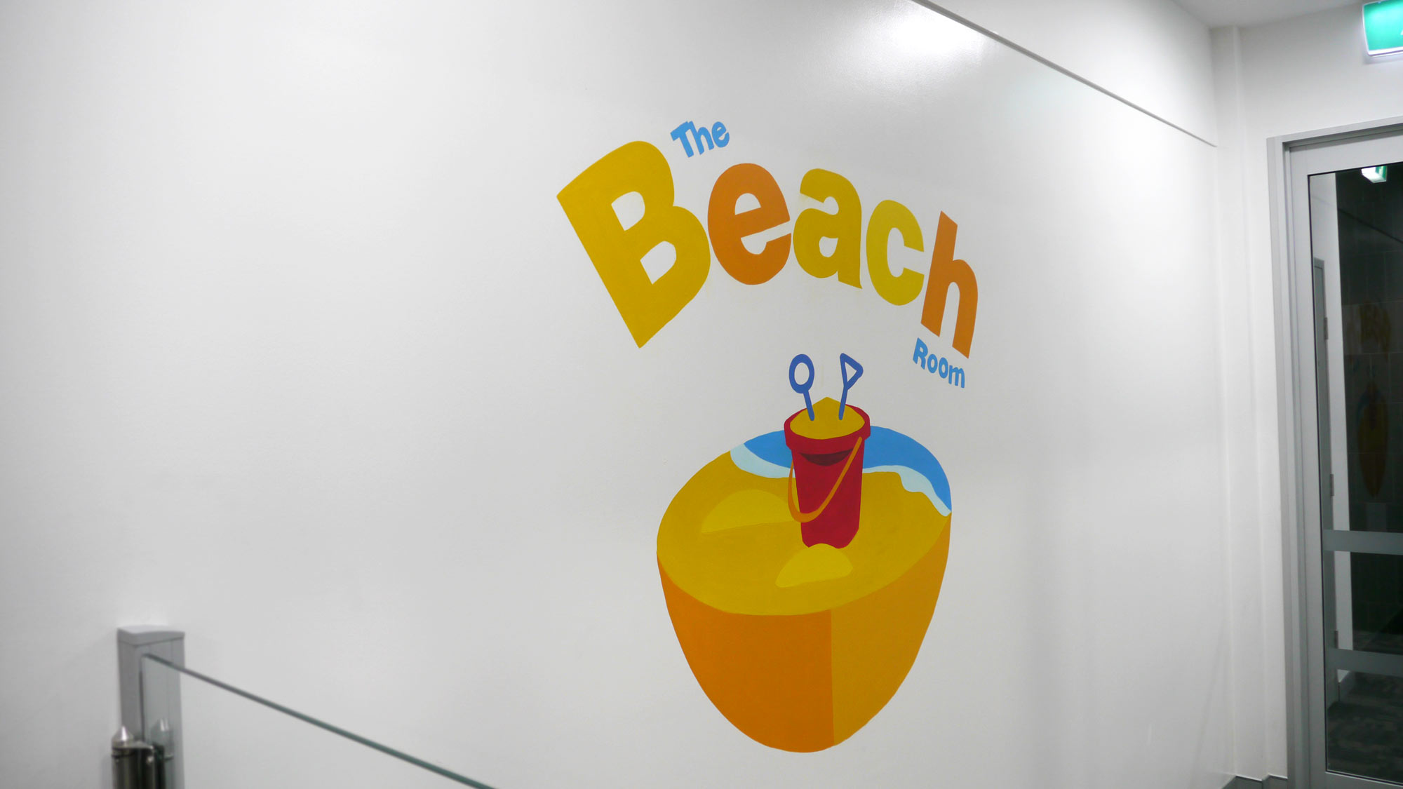 the-art-of-wall-child-care-center-mural-beach-room-title