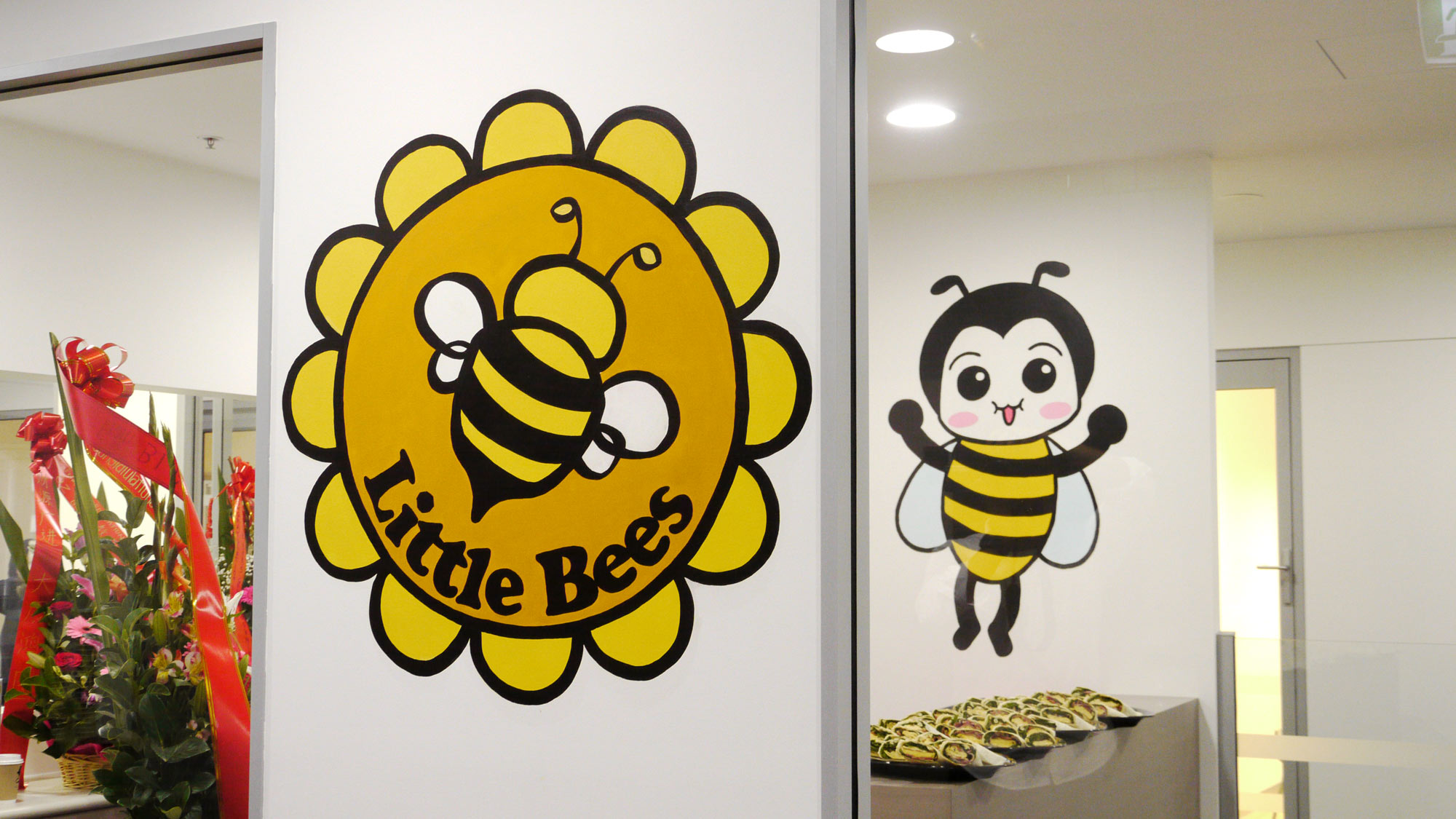 the-art-of-wall-little-bees-logo
